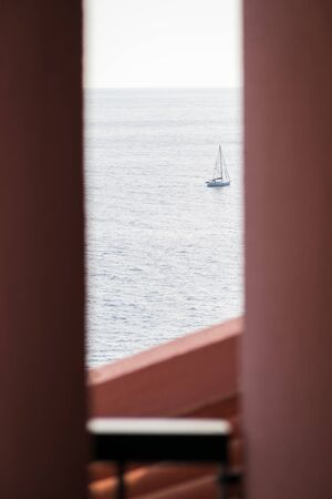 Sailboat heading for the open sea in summer in Madeira