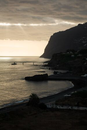 Light and shadows of a sunset on a beach of Madeira 스톡 콘텐츠