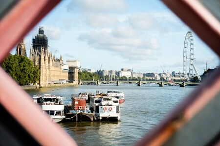 View of the Thames river, Big Ben in works and London Eye in London Stockfoto