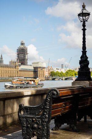 Big Ben in work from the Thames river quays in London