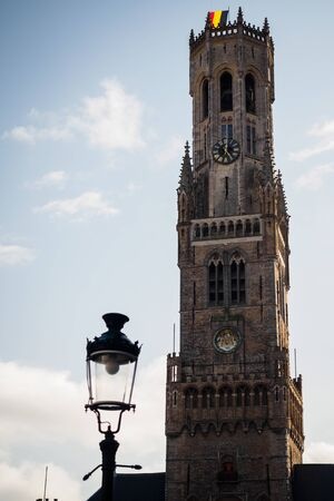 Belfry of Bruges with a lamp in the market square, Belgium