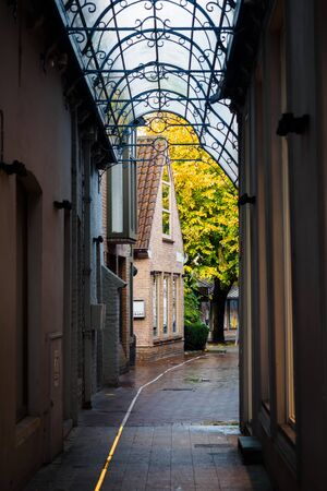 Covered passage in the alleys of Bruges in Belgium 스톡 콘텐츠