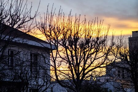 Colorful winter sunrise over the small town of Courbevoie 스톡 콘텐츠