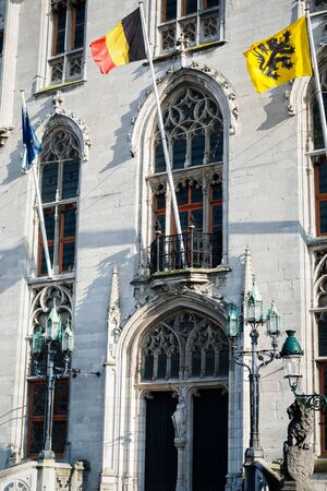 Belgian and European flags on the facade of the provincial palace in Bruges in Belgium