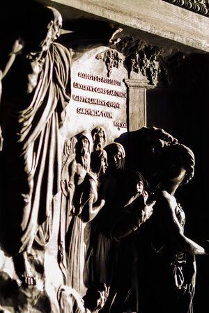 Sculpture between light and shadow of the door of the Madeleine church in Paris