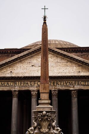 Raw facade of the Pantheon with its Obelisk in Rome, Italy