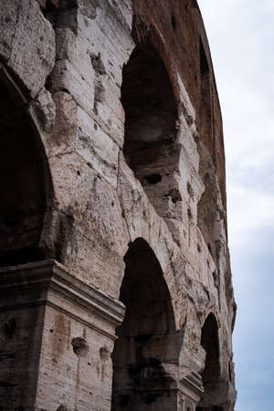 Facade of the Coliseum impacted by time in Rome, Italy