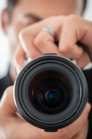 Camera held by a man vertically