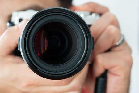 Man taking a photo holding a camera horizontally