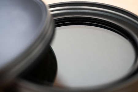 Polarizing filter for reflex camera lens in its elegant case