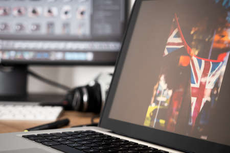 Workstation of a professional photographer developing his raw photos Archivio Fotografico
