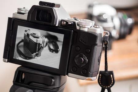 Camera taking a black & white photo on a tripod Archivio Fotografico