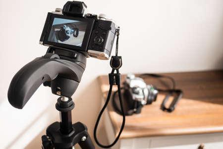 Camera taking a photo on a tripod