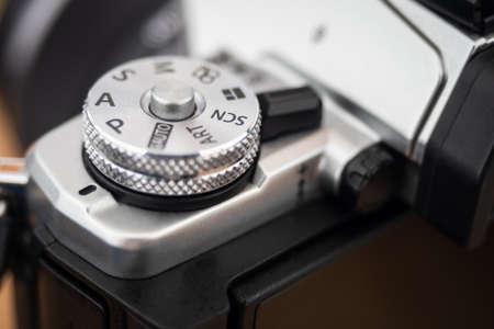 Close up on a camera P mode dial