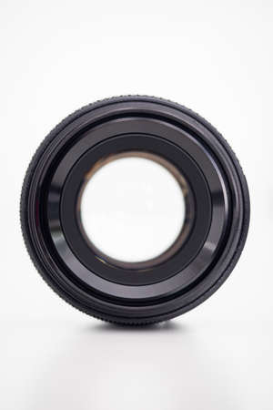 Wide aperture photo lens on white background