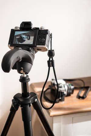 Camera taking a color photo on a tripod