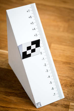 Paper test chart for auto focus calibration of a reflex camera