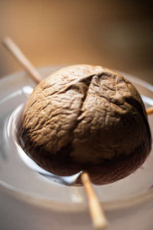 Avocado core germinating in its glass of water Archivio Fotografico