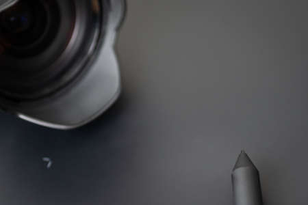 Post-processing with a graphics tablet, a stylus and lens