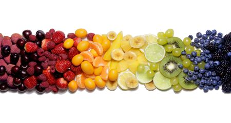 Rainbow colorful fruit selection in a white background