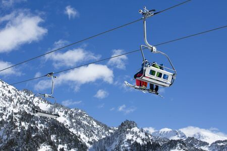 chairlift Snow and ski in mountains for a ski typical resort wellness winter Фото со стока