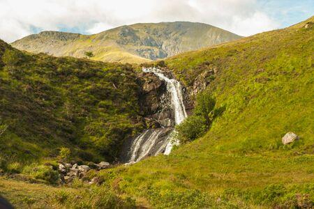 Waterfall in a green summer meadow of Skye Island tourism vacations in Scotland 版權商用圖片