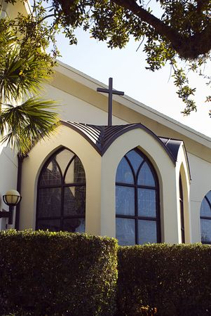 Church bay window with small cross over roof