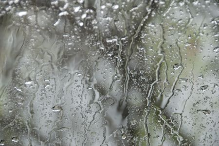 streaking: A background image of rain running down glass during a storm Stock Photo