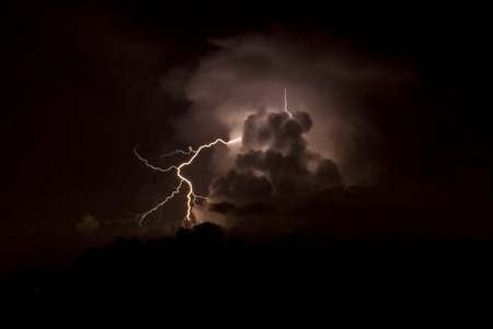 A close strike of lightning on a warm summer night Stock Photo - 1623334