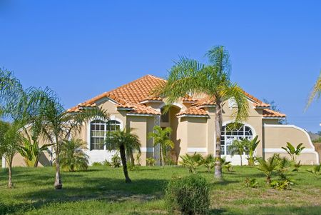 upscale: Upscale Spanish style home in Central Florida with blue sky