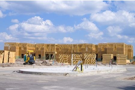 resident: Two story frame condos under construction and a clear day