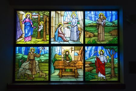 A colorful six pane stained glass church window Stock Photo