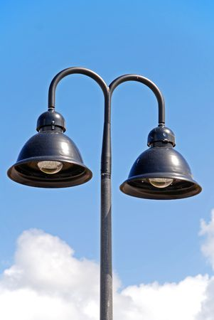 A double hooded street light with blue sky background photo