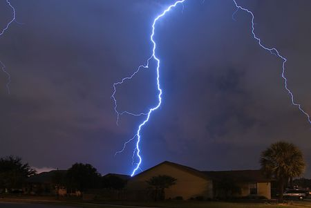 Spring storm lightning strike in a local neighborhood Stock Photo