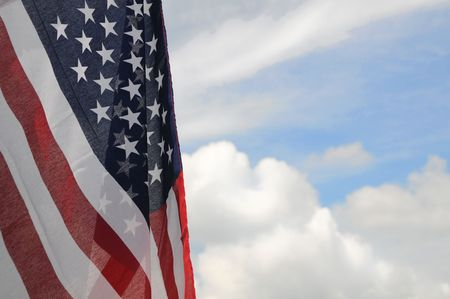United States flag with partly cloudy sky background Stock Photo