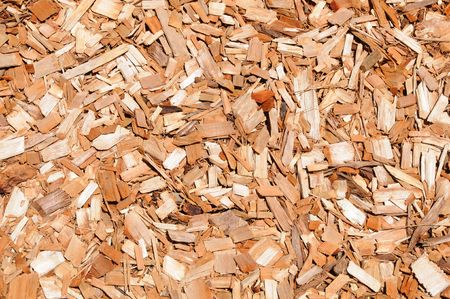Chips of orange cypress mulch for background use Stock Photo