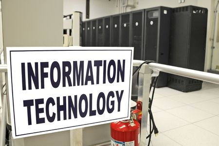 Information Technology data center room with data racks in the background Stock Photo
