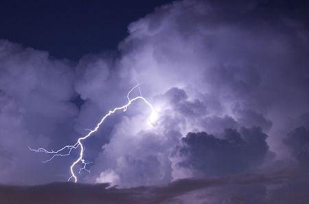 Telephoto image of a Lightning strike during a night storm Standard-Bild