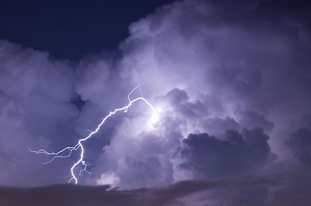 Telephoto image of a Lightning strike during a night storm Stok Fotoğraf