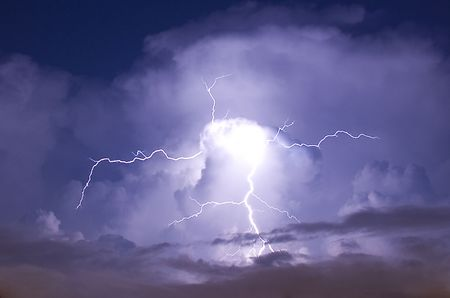 Telephoto image of a Lightning strike during a night storm Stock Photo
