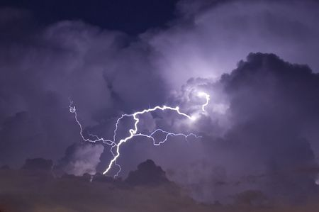 thundershower: Telephoto image of a Lightning strike during a night storm Stock Photo