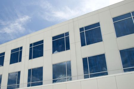 Commercial building with reflective windows and partly cloudy blue sky Stock Photo - 4134584