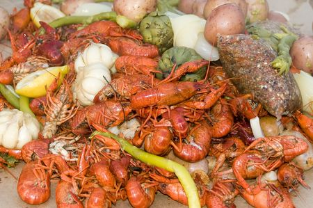 medley: Crayfish and crab legs with hearty vegetables medley   Stock Photo