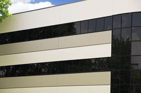 Corporate building with reflective windows and partly cloudy blue sky Stock Photo - 4805168