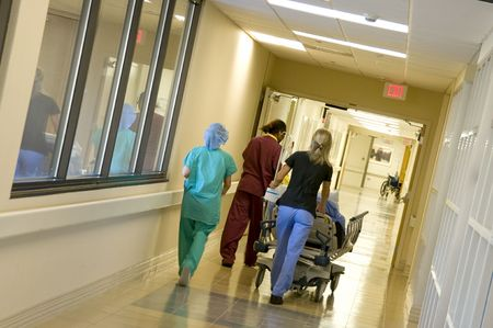 Rushing a patient to the emergency room for surgery