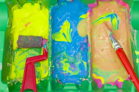 Childs colorful water paints with brush and roller Stock Photo