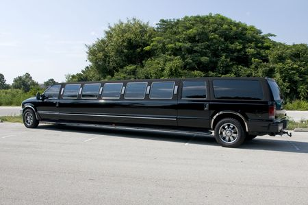 Black Stretch limousine waiting for guests to arrive Stock Photo