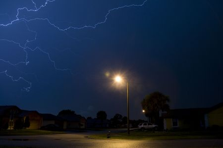 Electrical storm at night with street light in foreground Stock Photo - 5050527