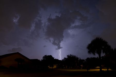 Lightning strike at night near residential area Stock Photo - 5112820