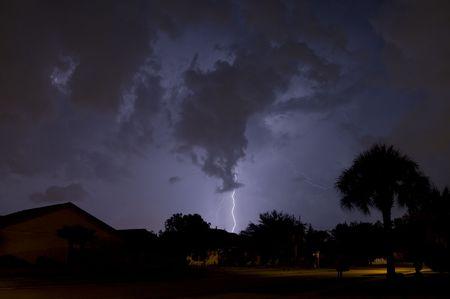 Lightning strike at night near residential area Stock Photo - 5112820